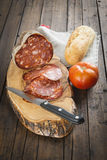 Morcon, una salchicha española con pan y el tomate imagen de archivo libre de regalías