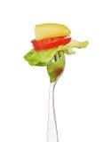 Mordedura de la ensalada en una fork Foto de archivo