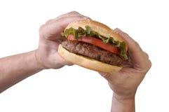 Mordedura de una hamburguesa Fotos de archivo