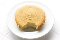 mordida no bolo da manteiga fotografia de stock