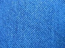 Mordido de la mezclilla azul Fotos de archivo