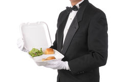 Mordomo com o recipiente de alimento Take-out fotos de stock royalty free