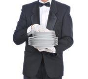Mordomo com placas Fotos de Stock