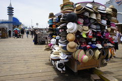 More Amazing Hats. Another group of amazing hats on the rolling store are on sale at the Sta. Monica Pier Stock Photos