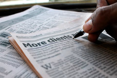 More Clients Newspaper. Close-up of a newspaper, who suggest how to make More Clients for Business and any other purpose royalty free stock photos