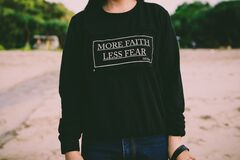 More Faith Less Fear White Sweater Stock Photography
