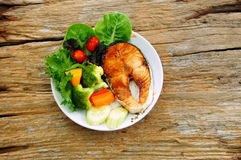 More fish dish is better. Salmon steak with some fresh vegetables is real clean dish Stock Images