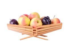 More fruits in basket, isolated on white Stock Photo
