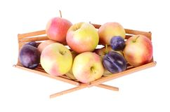 More fruits in basket, isolated on white Royalty Free Stock Image