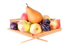More fruits in basket, isolated on white Stock Image