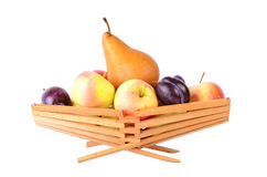 More fruits in basket, isolated on white Royalty Free Stock Photos
