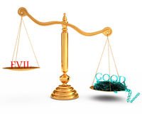 More good than evil in the gold scales Royalty Free Stock Photography