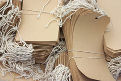 More Labels. Box with beige labels with strings Stock Photography