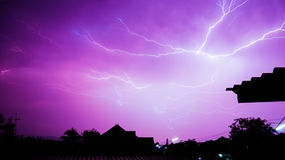 More lightning in the night sky near house. It very  dangerous if with out lightning rod Royalty Free Stock Images