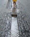 More London on the south bank of the Thames River. Photo shows legs of child playing in the waterin a channel in the street. Photo taken at More London on the royalty free stock photography
