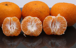 More oranges on the glass table Stock Images