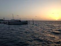 More sunrise from Caye Caulker. Sunrise with boats on Caye Caulker Royalty Free Stock Photo