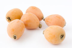 More than one loquat on white background. More than one loquat Stock Image