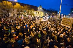 More than 60 thousand people hold an anti-government rally in Bratislava, Slovakia on March 16, 2018. BRATISLAVA, SLOVAKIA - MAR 16, 2018: Protesters hold signs Royalty Free Stock Image