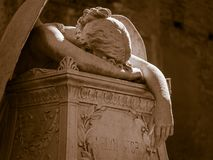Weeping angel. More than 100 years old statue. Cemetery located in Rome stock photography