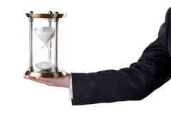 More time please. Businessman with hourglass in hand isolated on white Stock Photos