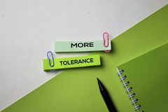 More Tolerance text on top view office desk table of Business workplace and business objects royalty free stock photography