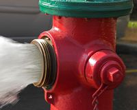 More Water. Closeup of fire hydrant spewing water Stock Photo