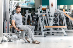 More weight. Confident athlete trainer weight loads. A young man Royalty Free Stock Photography