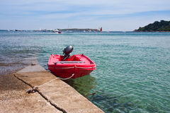 Mored boat at pier by high tide in France Royalty Free Stock Image