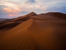 Moreeb dune in UAE. Sand dunes in the UAE desert near Liwa at sunset royalty free stock photography