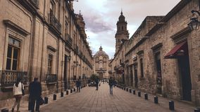 Morelia alley leading to cathedral stock images