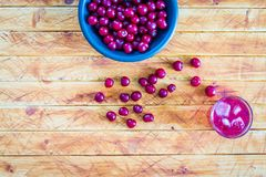 Morello cherries in a bowl and Cherry juice glass royalty free stock photo