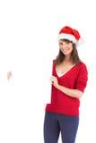 Morena festiva que guarda um cartaz Imagem de Stock