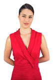 Morena 'sexy' satisfeita no levantamento vermelho do vestido Imagens de Stock