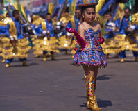 Morenada Dance Group - Arica, Chile. Girl dancer in a Morenada dance group performing a traditional ritual dance as part of the Carnaval Andino con la Fuerza del stock photo
