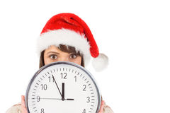 Morenita festiva que sostiene un reloj Imágenes de archivo libres de regalías