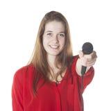 Morenita joven con el micrófono en estudio Fotos de archivo