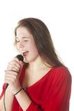 Morenita joven con el micrófono en estudio Imágenes de archivo libres de regalías