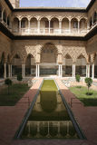 Moresque reflection. Real Alcazar in Sevilla, Spain royalty free stock photo
