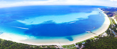 Moreton Island Aerial View. An aerial view of the beautiful crescent shaped bay and clear blue waters of Moreton Island, Australia Royalty Free Stock Photos