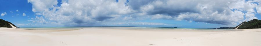 Moreton Island Panorama. Cape Moreton on Moreton Island with white sand, heavy clouds in the sky and clear water Royalty Free Stock Image