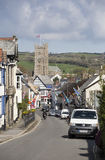 Moretonhampstead Main Street during Flag Festival. The historic village of Moretonhampstead on Dartmoor during the annual flag day when buildings are decorated stock image