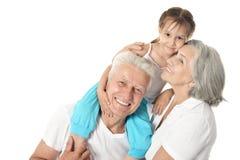 Morföräldrar med lilla flickan arkivfoto