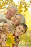 Morföräldrar och sonson Fotografering för Bildbyråer