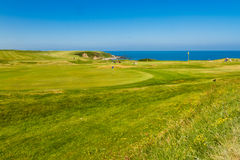MORFA NEFYN – JUNE 3: Golf course putting green with golfers, Royalty Free Stock Images
