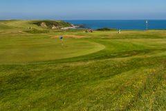 MORFA NEFYN – JUNE 3: Golf course putting green with golfers, Stock Photography