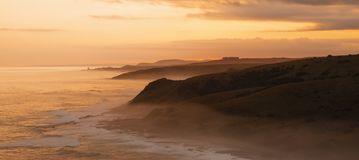 Morgan Bay Cliffs at Sunset. Morgan Bay Cliffs on the Wild Coast at a misty Dusky Sunset stock photography