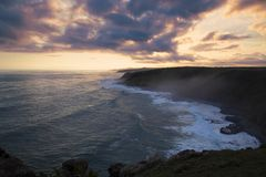 Morgan Bay Cliffs at Sunset. Morgan Bay Cliffs on the Wild Coast at a misty Dusky Sunset royalty free stock photography