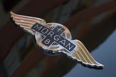 Morgan Cars Logo. The Morgan logo on the hood of a classic Morgan Plus 8 car royalty free stock photo