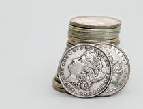 1896 and 1880 Morgan Dollar coins. Lean on a stack of other Morgans Royalty Free Stock Photos